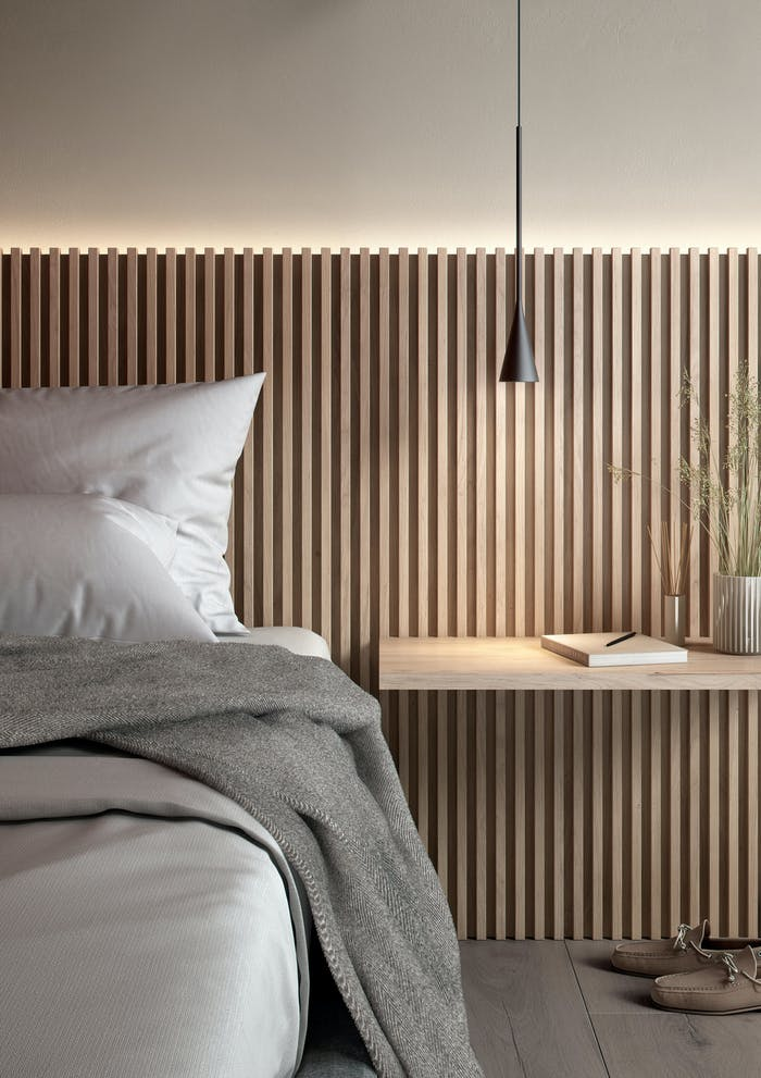 """Bedroom with a wooden wall headboard and delicate light.<span class=""""sr-only""""> (opened in a new window/tab)</span>"""