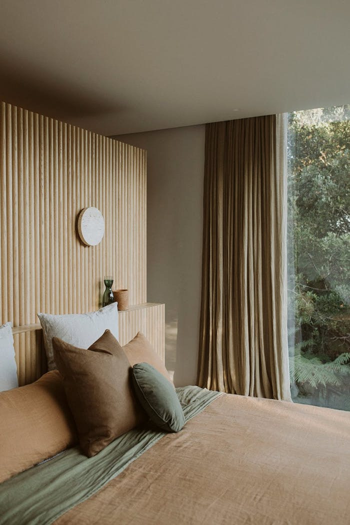 """Bedroom with a soft earthy colour palette of greend and tans.<span class=""""sr-only""""> (opened in a new window/tab)</span>"""
