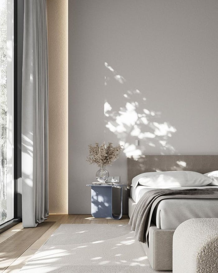 """Bedroom with a delicate shadow of outdoor greenery reflecting on the wall.<span class=""""sr-only""""> (opened in a new window/tab)</span>"""