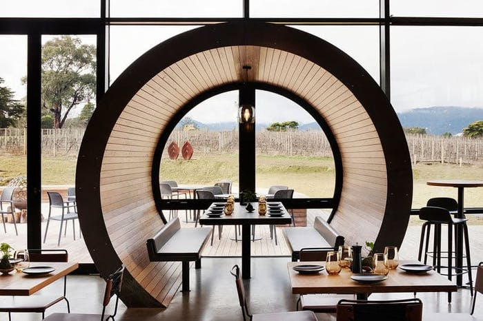 "Restaurant table enclosed in a rounded wood structure.<span class=""sr-only""> (opened in a new window/tab)</span>"