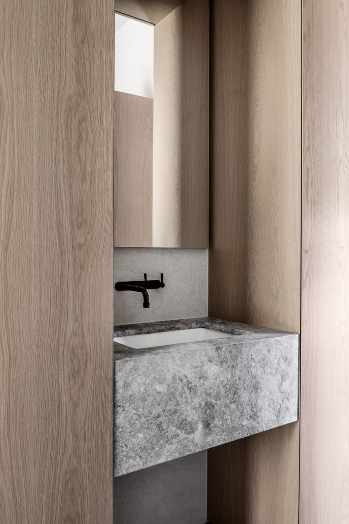 """Stone lavabo encased in the wooden storage.<span class=""""sr-only""""> (opened in a new window/tab)</span>"""