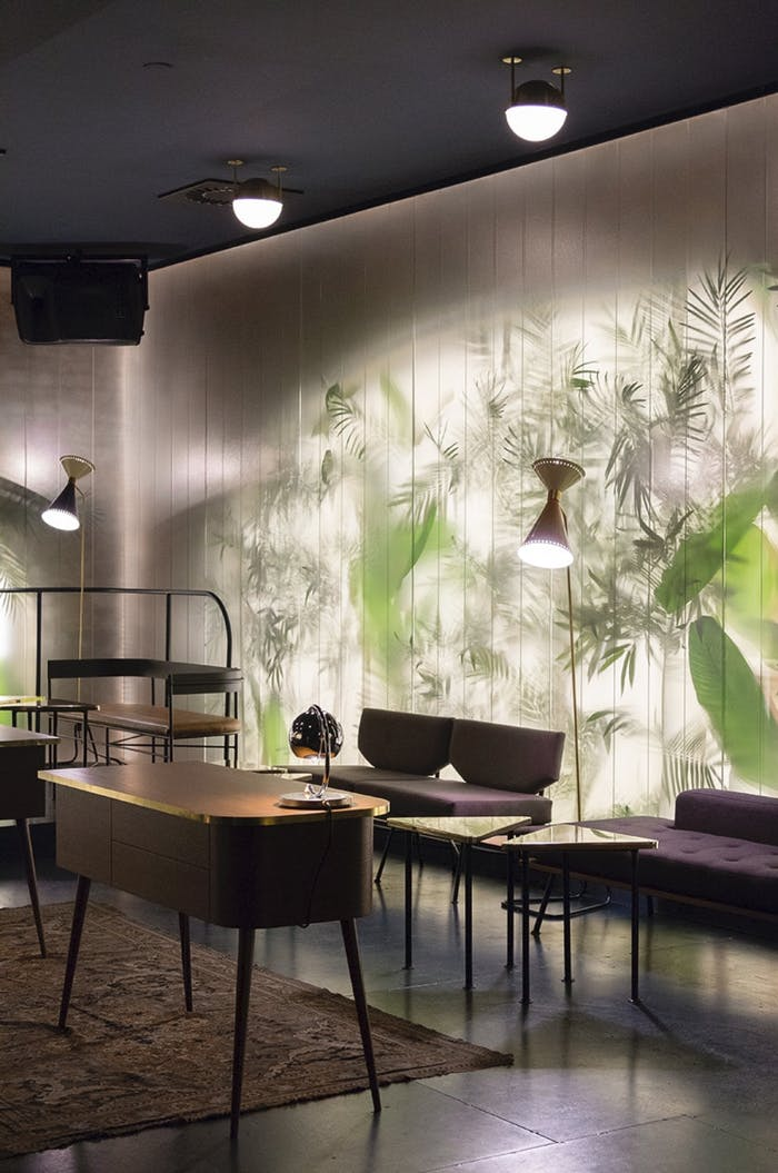 """Frosted glass wall showing the texture of plants placed behind it.<span class=""""sr-only""""> (opened in a new window/tab)</span>"""
