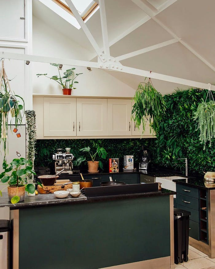 """Kitchen back wall covered in plants.<span class=""""sr-only""""> (opened in a new window/tab)</span>"""