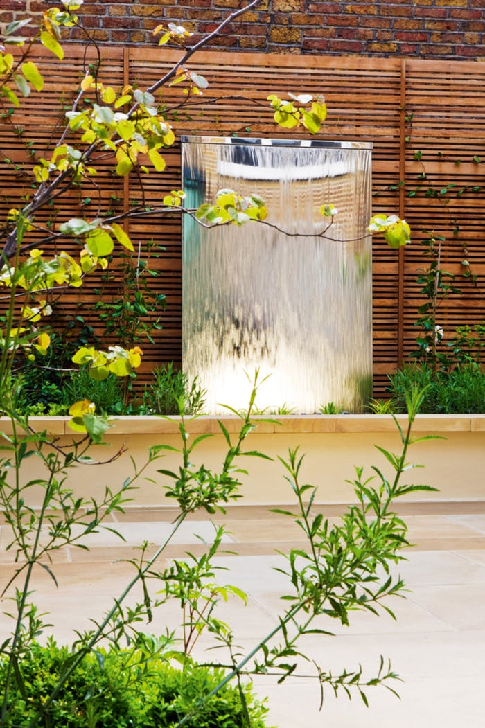 "Outdoor water wall, great element to a biophilic outdoor design.<span class=""sr-only""> (opened in a new window/tab)</span>"