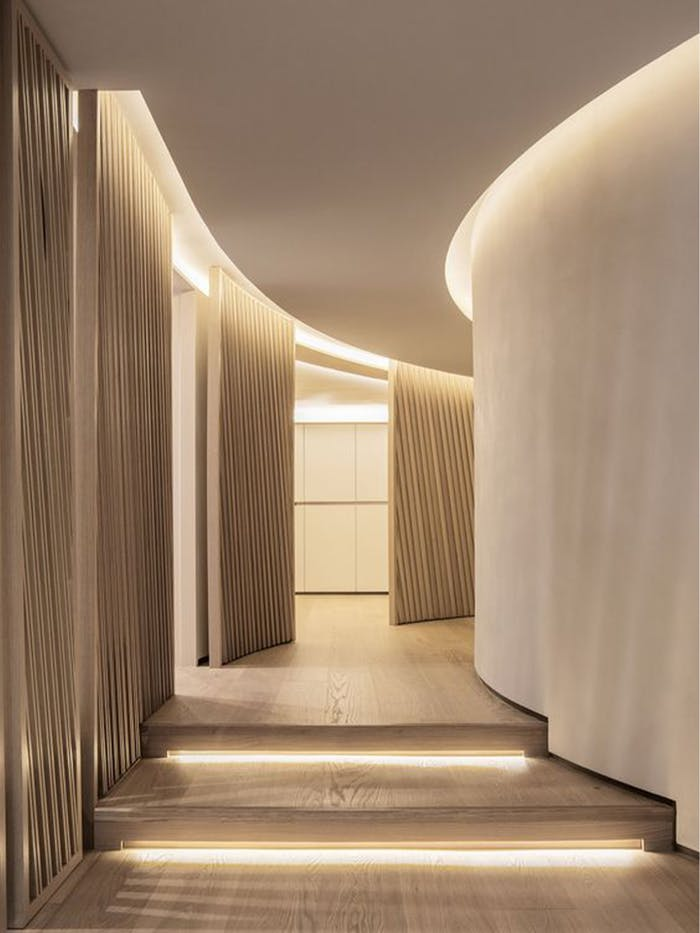 """Curved corridor with light strips leading the way.<span class=""""sr-only""""> (opened in a new window/tab)</span>"""