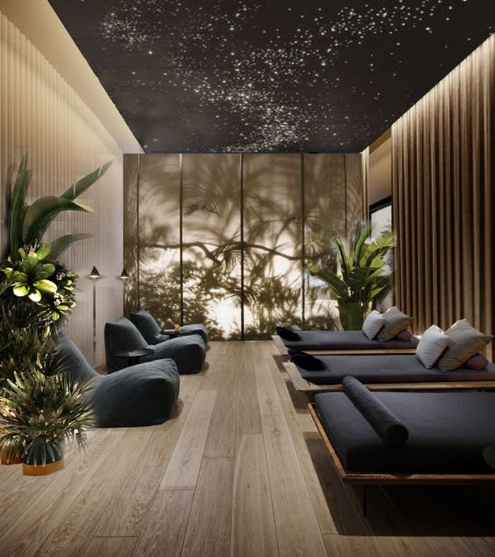 """Massage room with ceiling lights in the shape of a star constellation.<span class=""""sr-only""""> (opened in a new window/tab)</span>"""