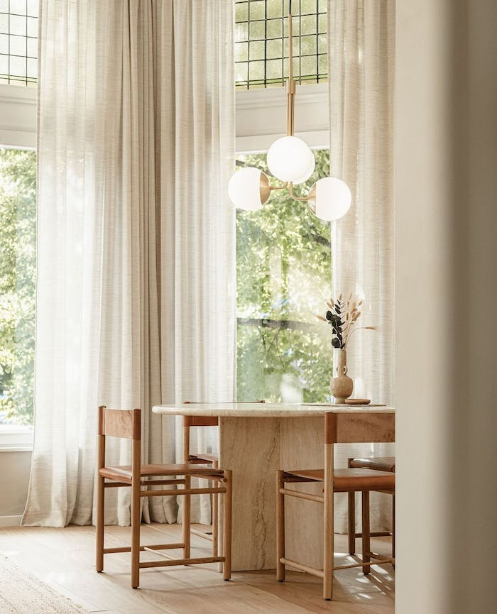 """Biophilic dining room with big windows overlooking greenery.<span class=""""sr-only""""> (opened in a new window/tab)</span>"""