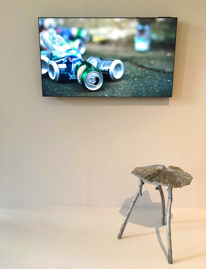 """Photo of a stool made with recycled aluminum cans.<span class=""""sr-only""""> (opened in a new window/tab)</span>"""