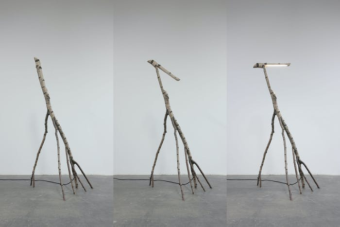 "Floor lamp made out of a savaged tree trunk.<span class=""sr-only""> (opened in a new window/tab)</span>"