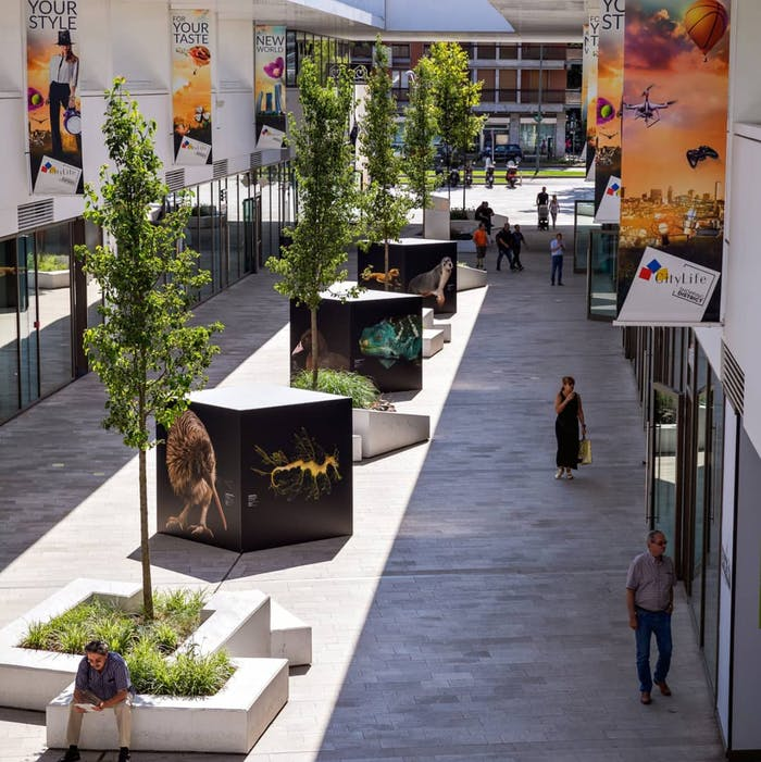 "A closer outdoor view of CityLife shopping district, an example of biophilic design.<span class=""sr-only""> (opened in a new window/tab)</span>"