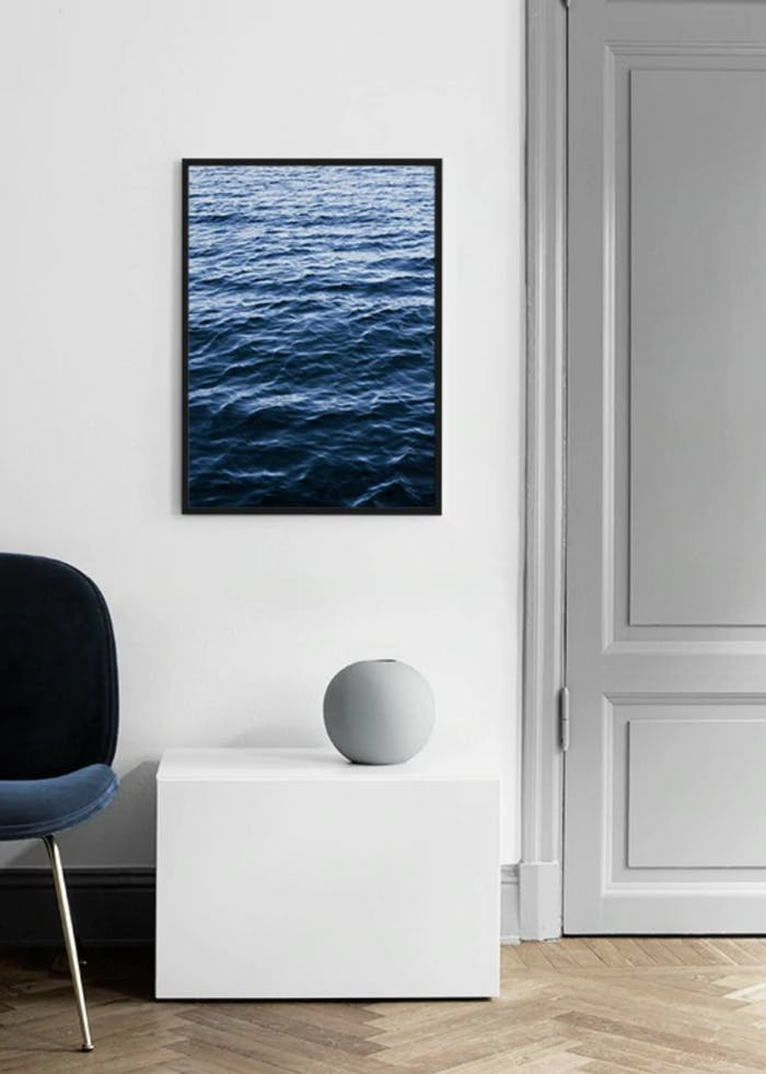 """Artwork representing the texture of water on a white wall surrounded by minimal furnishings.<span class=""""sr-only""""> (opened in a new window/tab)</span>"""