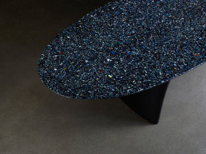 "Close-up of the bench top texture made using ocean plastic fragments.<span class=""sr-only""> (opened in a new window/tab)</span>"