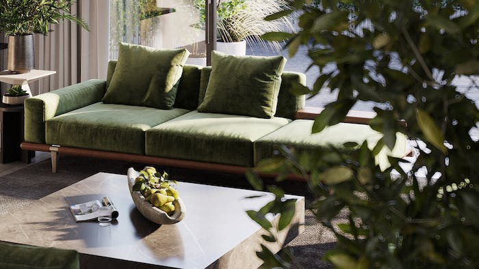 "Close-up shot of a sofa in a room full of greenery that overlooks a light patio.<span class=""sr-only""> (opened in a new window/tab)</span>"