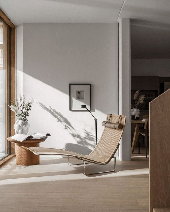 """A reading corner furnished with a sculptural chiase longue in front of a big window.<span class=""""sr-only""""> (opened in a new window/tab)</span>"""