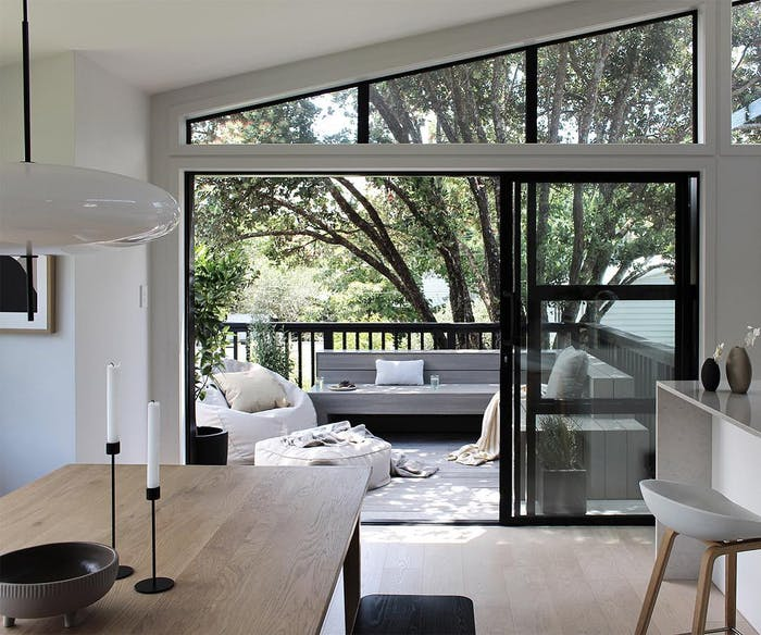 """Living area with a terrace full of green.<span class=""""sr-only""""> (opened in a new window/tab)</span>"""