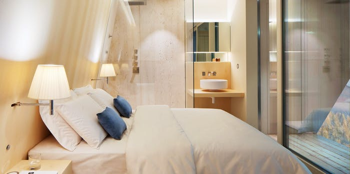 """The interior of EDEN luxury portable suite, an example of sustainable living and energy efficiency. View of the bathroom sink and shower.<span class=""""sr-only""""> (opened in a new window/tab)</span>"""