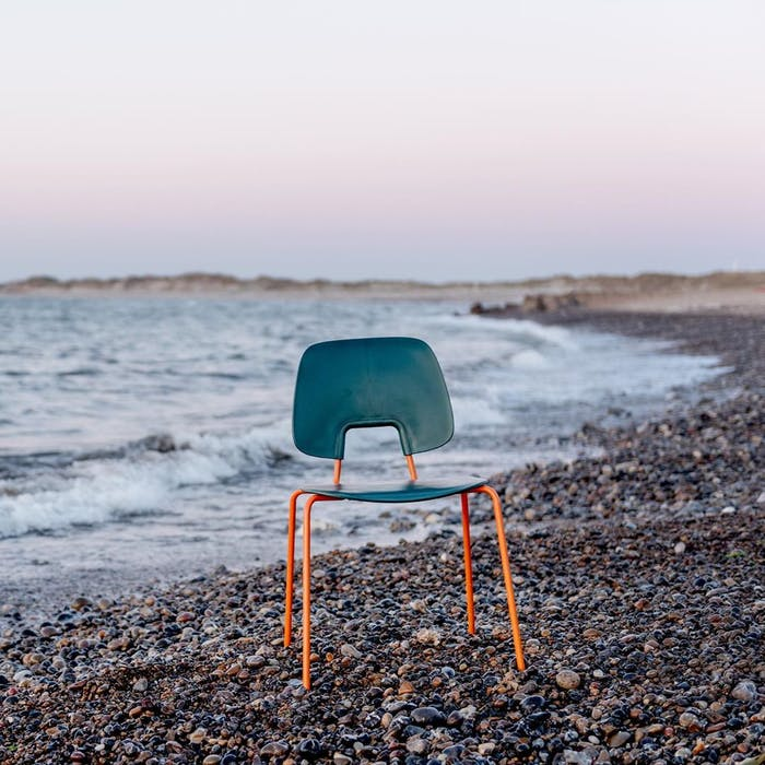 """Chair made with fishing net and recycled steel.<span class=""""sr-only""""> (opened in a new window/tab)</span>"""