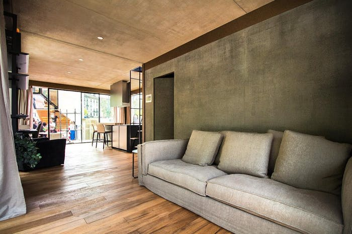 """The interior of Genesi House, an example of sustainable living and energy efficiency. View of the entrance and flexible living/sleeping area.<span class=""""sr-only""""> (opened in a new window/tab)</span>"""