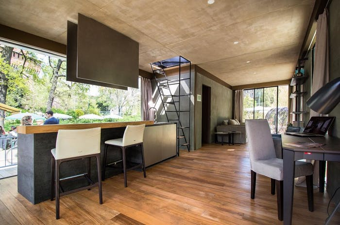 """The interior of Genesi House, an example of sustainable living and energy efficiency. View of the kitchen and dining areas.<span class=""""sr-only""""> (opened in a new window/tab)</span>"""