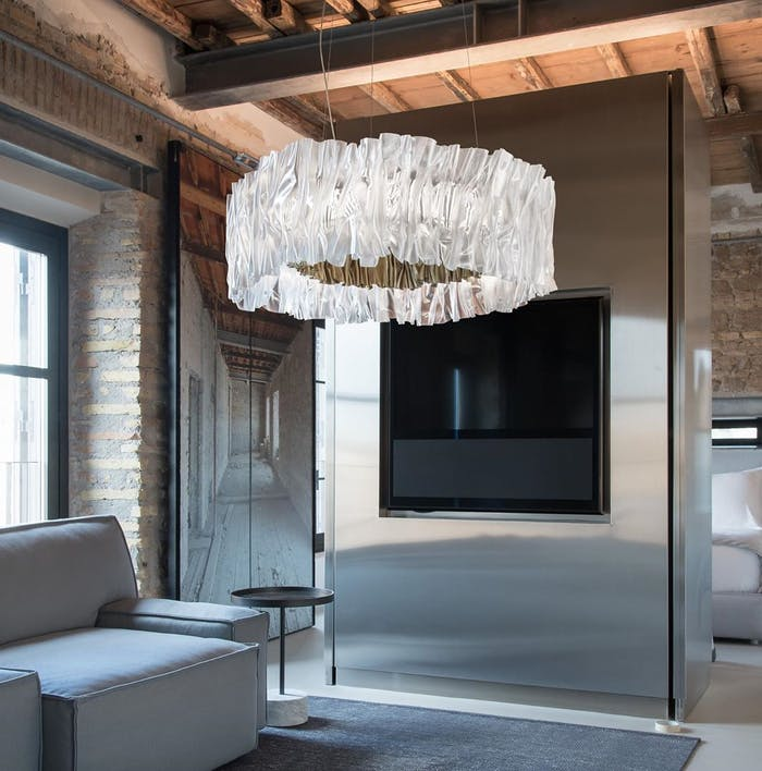 """Contemporary interior with a big overhead pendant light.<span class=""""sr-only""""> (opened in a new window/tab)</span>"""