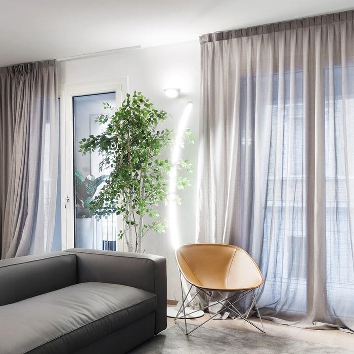 """Minimal seating area with lighting behind.<span class=""""sr-only""""> (opened in a new window/tab)</span>"""