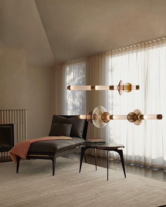 "Modular pendant light made of individual blown-glass tubes.<span class=""sr-only""> (opened in a new window/tab)</span>"