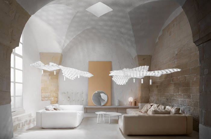"Huge pendant light over a sofa. Its draping look is achieved with individual white modules interlocked.<span class=""sr-only""> (opened in a new window/tab)</span>"