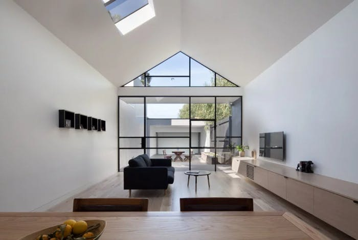 """Open plan minimal apartment, with uninterrupted view from the kitchen to the patio, great example of biophilic design.<span class=""""sr-only""""> (opened in a new window/tab)</span>"""