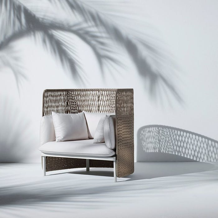 "High back white outdoor sofa with a woven back.<span class=""sr-only""> (opened in a new window/tab)</span>"
