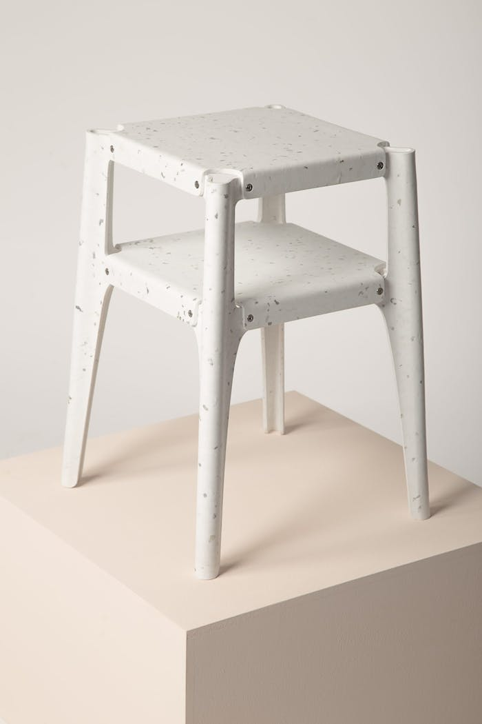 """Recycled plastic stool winning the Guiltless Plastic Prize: one of the plastic recycling initiatives presented at Milan Design Week.<span class=""""sr-only""""> (opened in a new window/tab)</span>"""