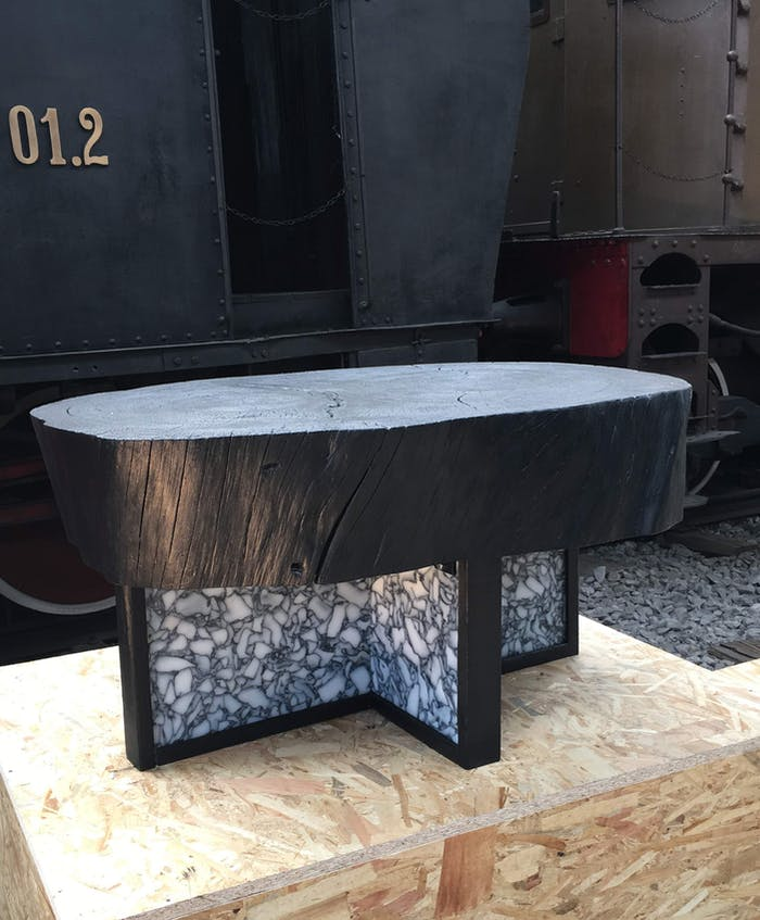 """Black coffee table with wooden top and recycled plastic base; one of the plastic recycling design projects joining the Guiltless Plastic Initiative.<span class=""""sr-only""""> (opened in a new window/tab)</span>"""