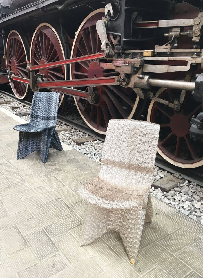 """Recycled plastic chairs; clear and black.<span class=""""sr-only""""> (opened in a new window/tab)</span>"""