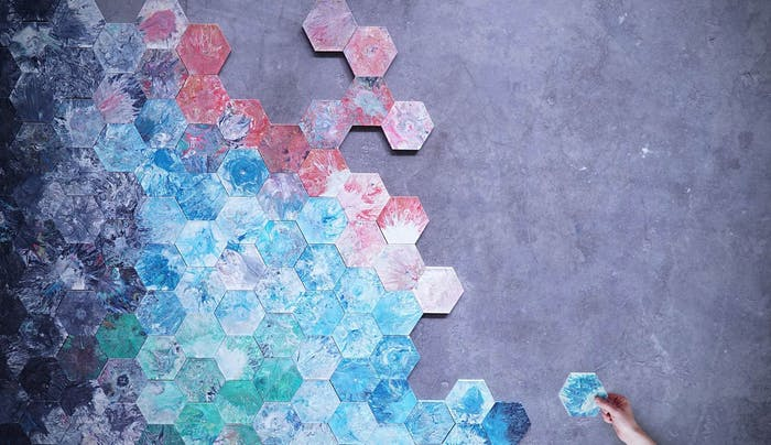 """A wall of hexagonal recycled plastic tiles.<span class=""""sr-only""""> (opened in a new window/tab)</span>"""