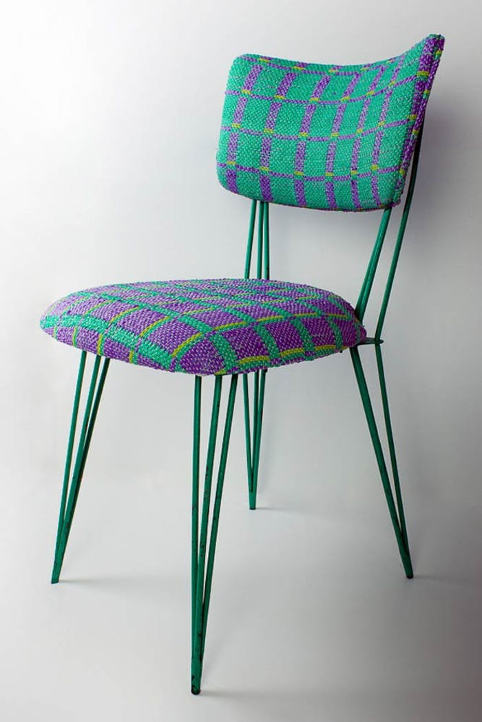 """Metal chair with seat upholstered with Plastex, a sustainable material made recycling plastic bags.<span class=""""sr-only""""> (opened in a new window/tab)</span>"""