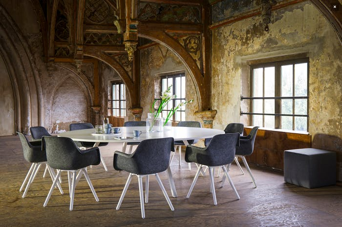 """Round table with chairs designed with circular principles in mind.<span class=""""sr-only""""> (opened in a new window/tab)</span>"""