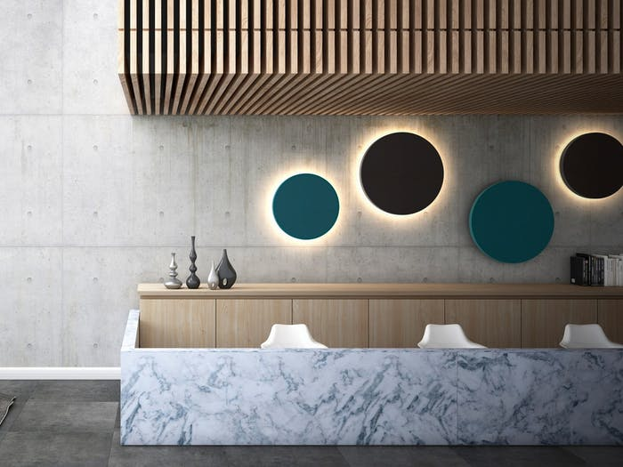 """Contemporary room with round colorful acoustic panels with integrated backlight used as art.<span class=""""sr-only""""> (opened in a new window/tab)</span>"""