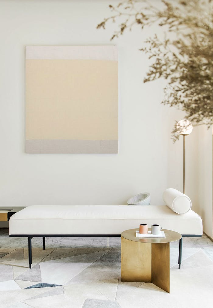 "A minimal seating area: white daybed, gold side table and a minimal watercolor art in the background. Perfect setup to enjoy a silent moment.<span class=""sr-only""> (opened in a new window/tab)</span>"