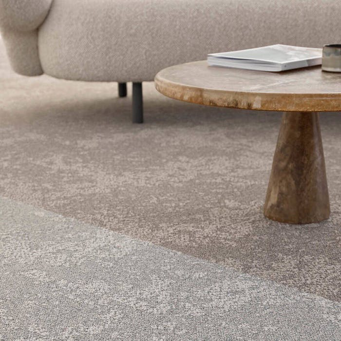 """Close-up of a carpet material and stone side table.<span class=""""sr-only""""> (opened in a new window/tab)</span>"""