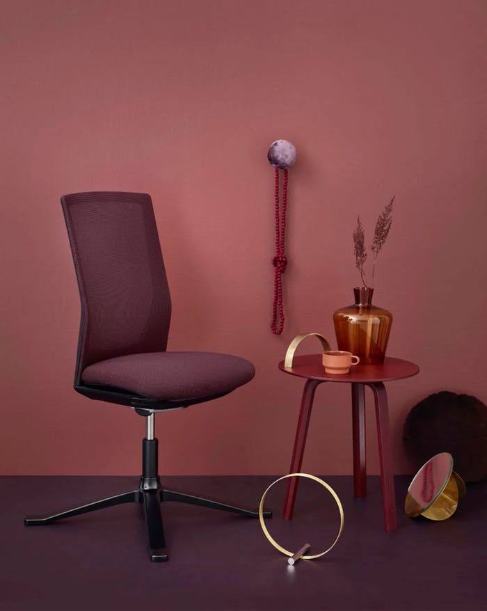 """Office chair styled together with colour-coordinated burgundy objects.<span class=""""sr-only""""> (opened in a new window/tab)</span>"""