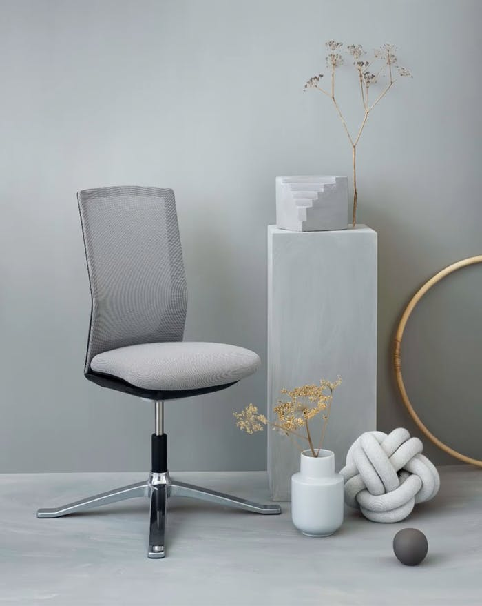 """Office chair styled together with colour-coordinated grey objects.<span class=""""sr-only""""> (opened in a new window/tab)</span>"""