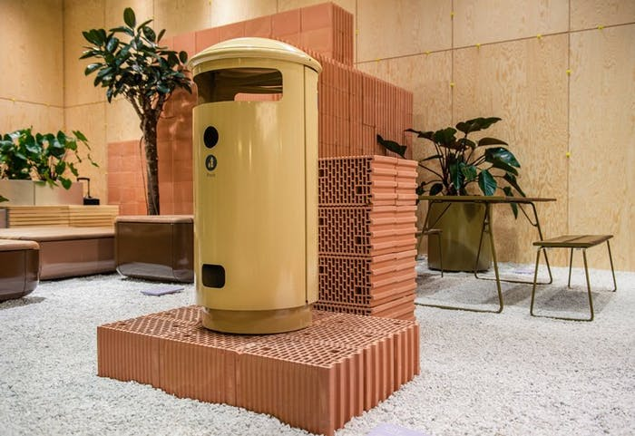 """Fair booth made with bricks gravel and wood: close-up.<span class=""""sr-only""""> (opened in a new window/tab)</span>"""