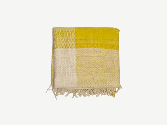 """Blanket with yellow and beinge squares.<span class=""""sr-only""""> (opened in a new window/tab)</span>"""