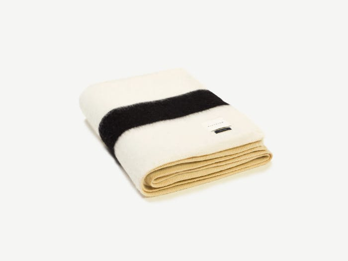 """White blanket with a black stripe on the bottom.<span class=""""sr-only""""> (opened in a new window/tab)</span>"""
