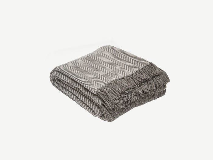 """Taupe blanket with a herringbone pattern.<span class=""""sr-only""""> (opened in a new window/tab)</span>"""