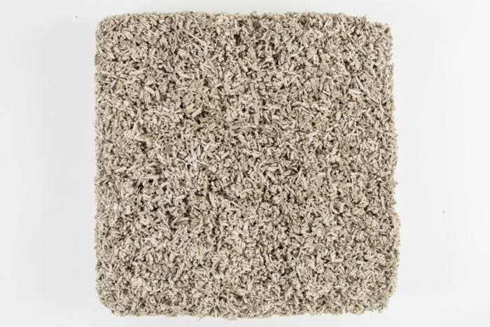 """Close-up of a hemp concrete brick.<span class=""""sr-only""""> (opened in a new window/tab)</span>"""