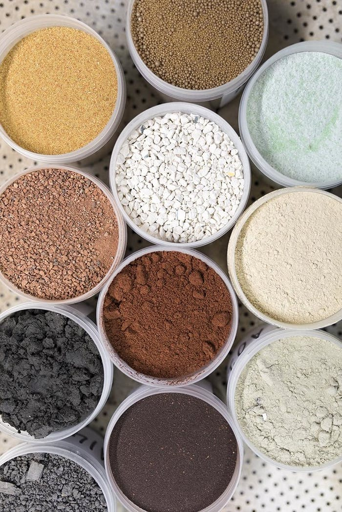 """Crushed demolition debris sorted by colour, that are the raw material of waste-based bricks.<span class=""""sr-only""""> (opened in a new window/tab)</span>"""