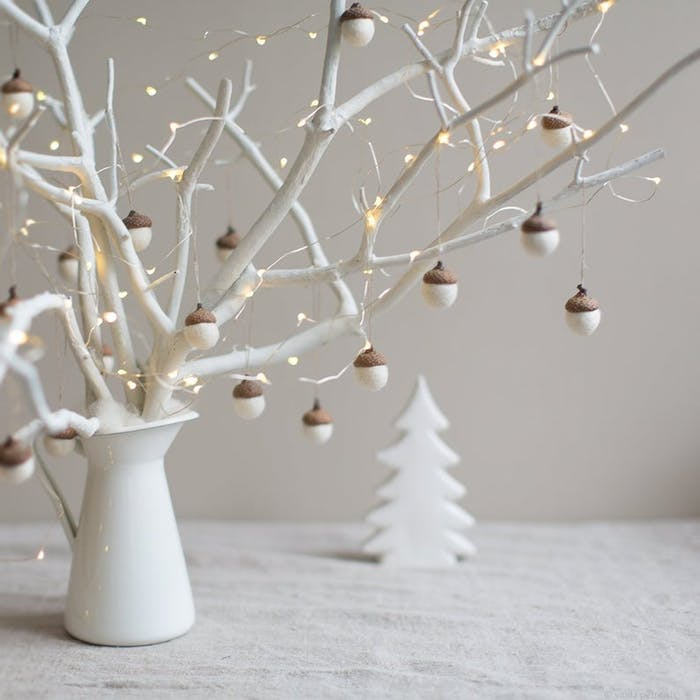 """Branch decorated with acorns with a felt body mounted on real tops.<span class=""""sr-only""""> (opened in a new window/tab)</span>"""
