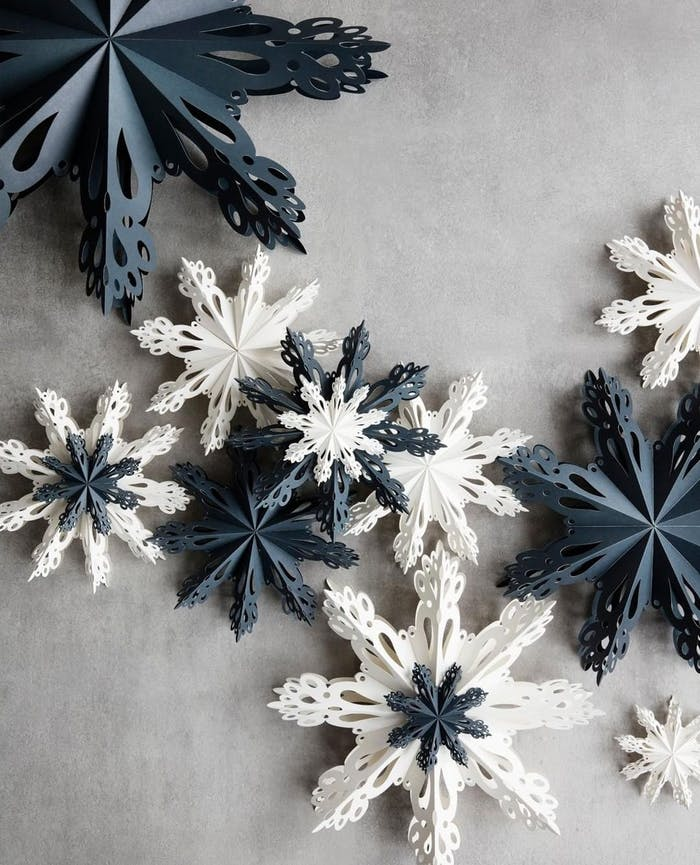 """Flatlay of blue and white paper stars.<span class=""""sr-only""""> (opened in a new window/tab)</span>"""