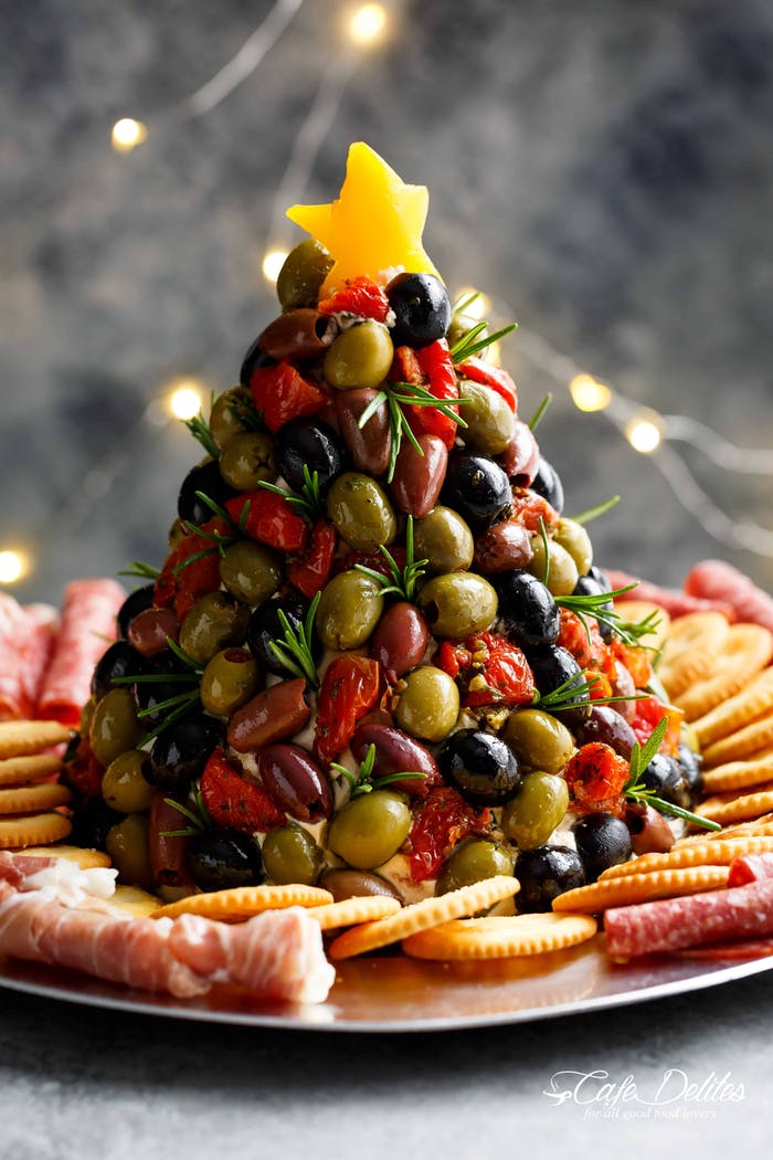 """Olives and dried tomatoes arranged in the shape of a Christmas tree.<span class=""""sr-only""""> (opened in a new window/tab)</span>"""