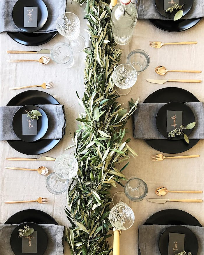 "Black and gold table setting with olive branches as a centrepiece.<span class=""sr-only""> (opened in a new window/tab)</span>"